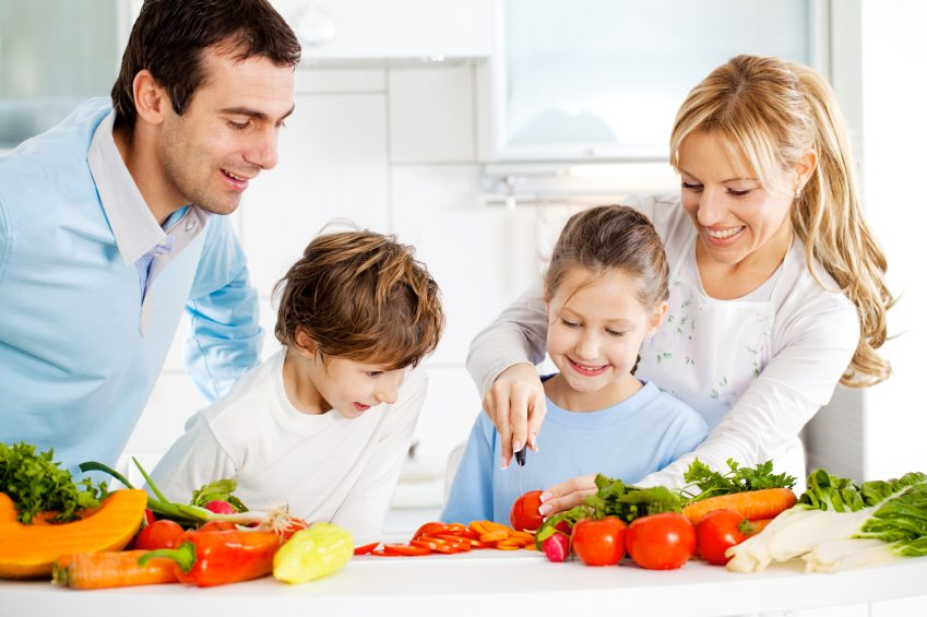 Happy family preparing meal together in the kitchen.