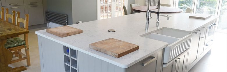 white granite cottage kitchen work surfaces