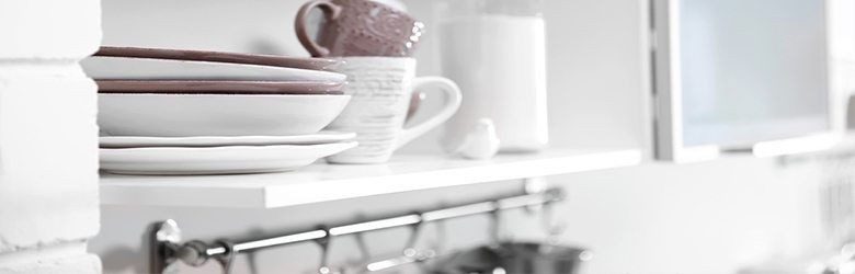 plates and cups on a kitchen shelf