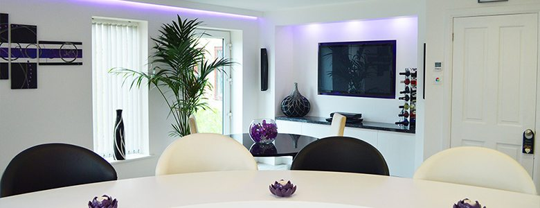 purple coloured lighting used in a kitchen