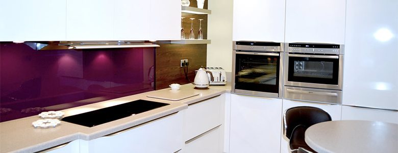 purple coloured splashback used in a modern kitchen