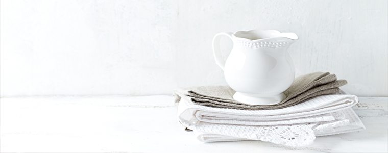 Ceramic jug and tea towels